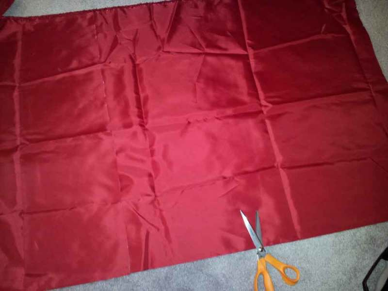 red fabric about to be cut