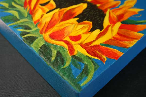 "Corner detail of ""All Ablaze"" sunflower painting on gallery wrapped canvas"