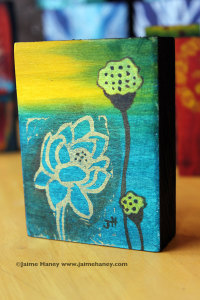 Lotus hand carved stamp mono-print on blue-green and yellow block of wood