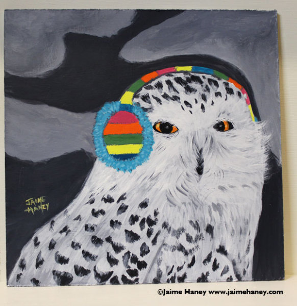 """painting #8 titled """"I'm all ears"""" is a painting of a snowy owl with colorful ear muffs on"""