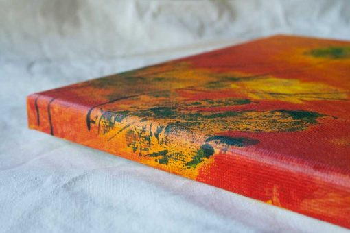 Side view of canvas of abstract painting Warm Release