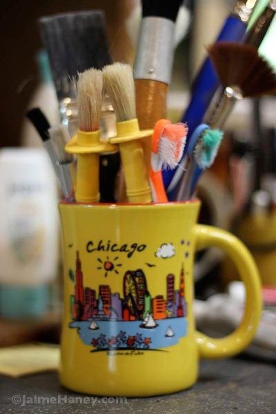 coffee mug used to hold paint brushes