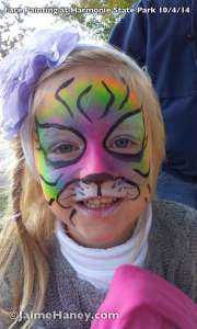 Happy Rainbow Tiger face paint