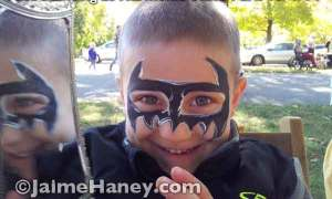 Batman painted mask on happy boy
