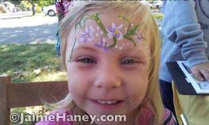 sweet flower garland on forehead of little girl