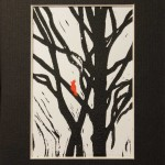 red bird perched on black tree branches mono-prin