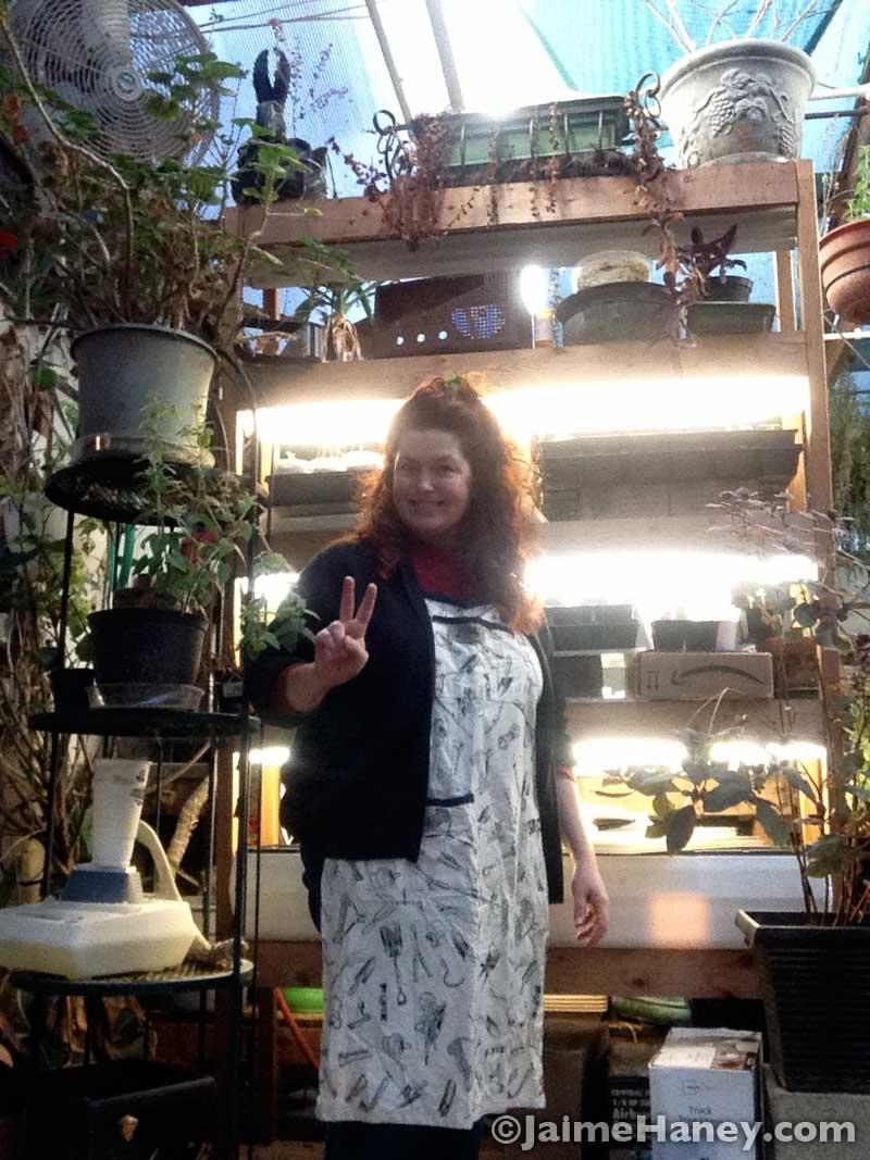 Jaime Haney, artist, in her greenhouse