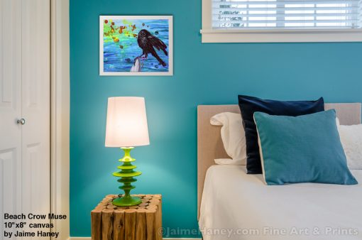 Beach Crow Muse painting shown framed and hung in bedroom
