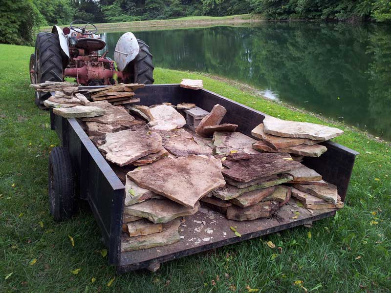 trailer full of flagstone to be used for rustic stone steps and path