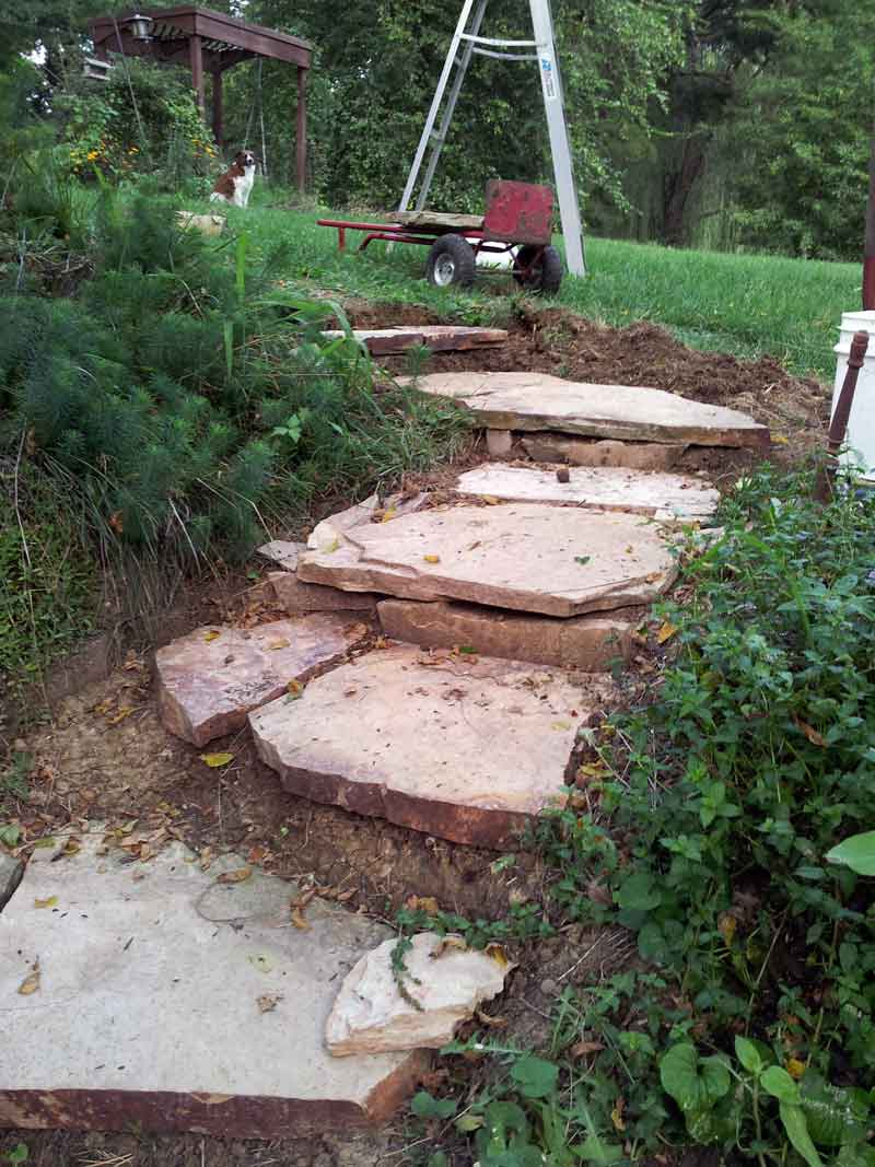 close up photo of the top of the rustic stone stairs