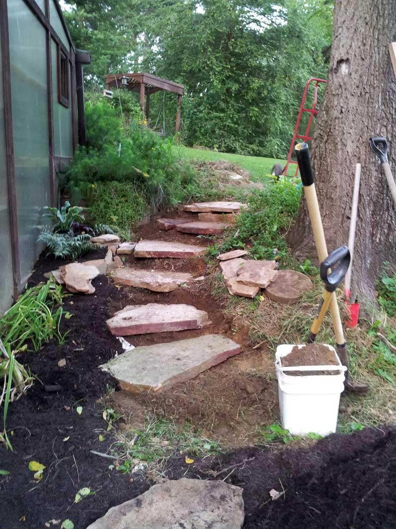 Carving rustic stone steps out of hillside with flagstone for Rustic landscaping