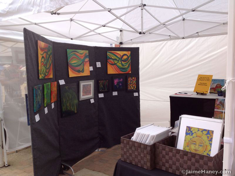 outside art show booth with tent, inside view