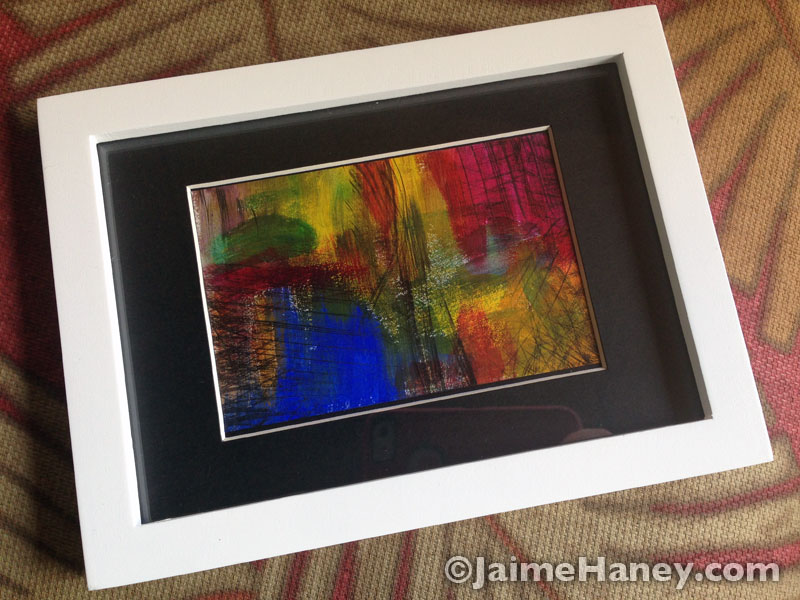 Small original abstract painting shown horizontally in frame for March art giveaway
