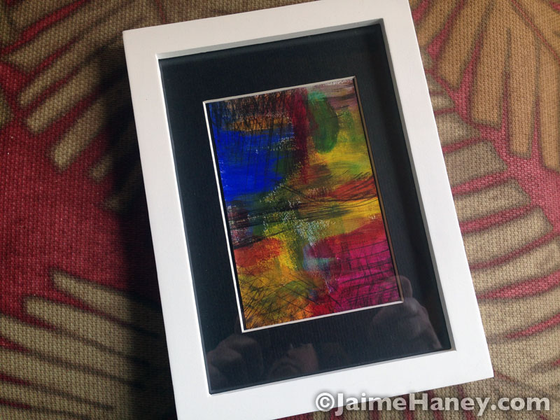 Small original abstract painting shown vertically in frame for March art giveaway