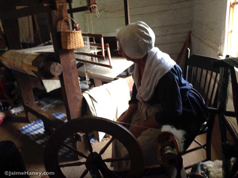 Weaver Peggy Taylor in 1800's costume during Heritage Artisans Days in New Harmony Indiana 2016