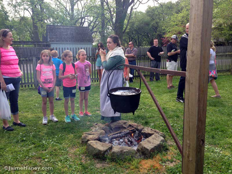 children watching candle dipping demonstrations at the Heritage Artisans Days in New Harmony Indiana 2016