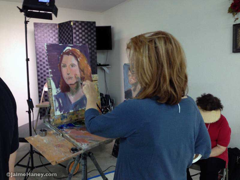 Diane May working on her painting