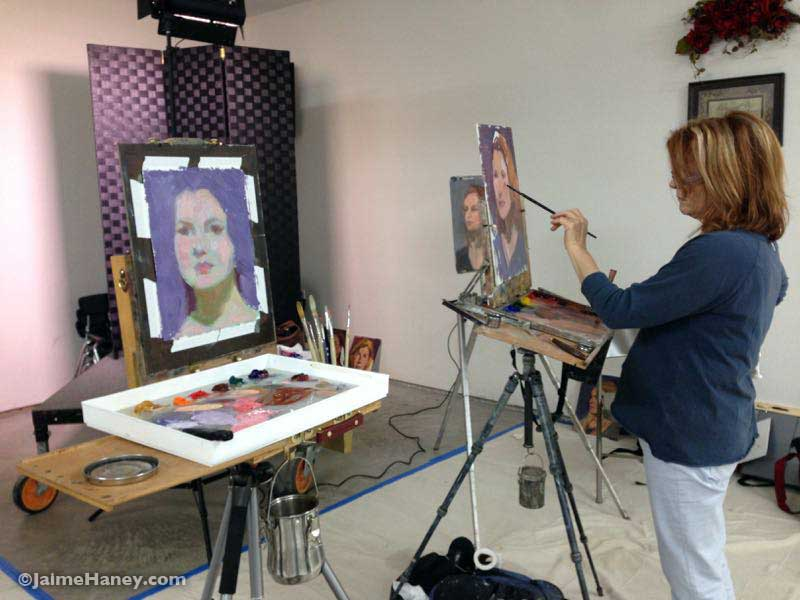 Charlene Browns painting and Diane May working on her painting