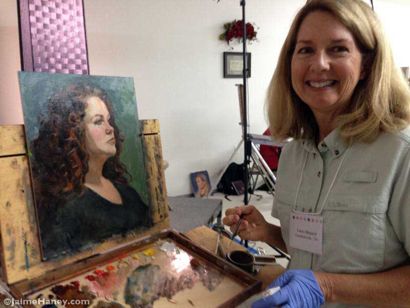 Artist Laura Shepard with her finished painting