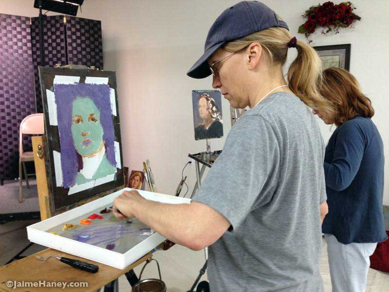 artist Charlene Brown painting a portrait