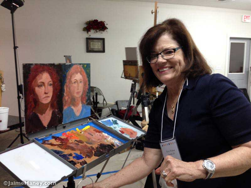 Terry Watson with her finished portraits