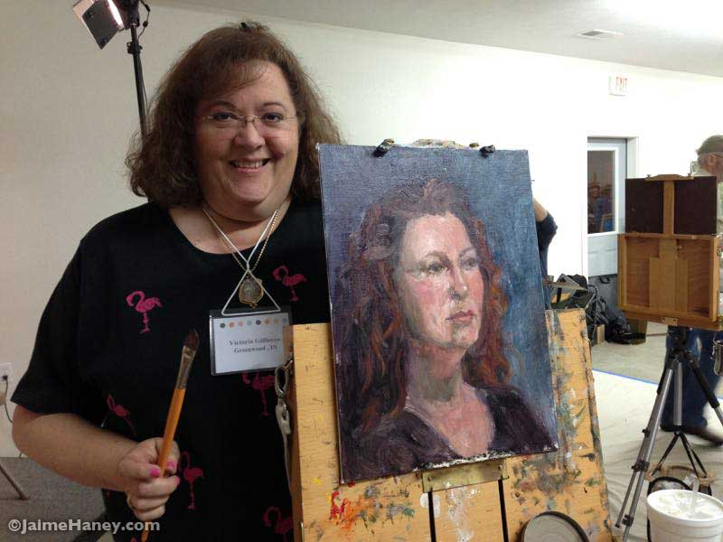 Artist Victoria Gillieron with her portrait of me