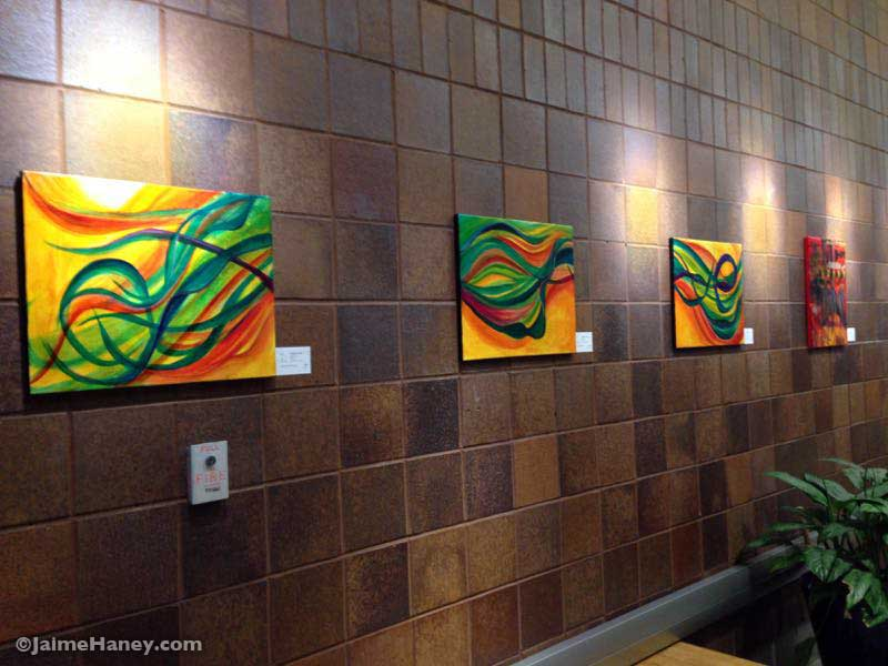 paintings in an art exhibit at Alexandrian Library