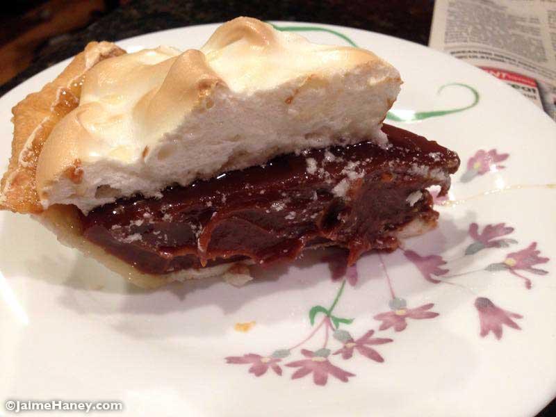 slice of homemade chocolate pie with meringue