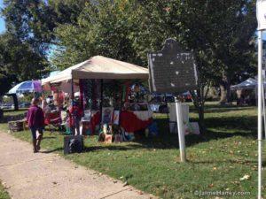 booths along sidewalk at DHP artisans market
