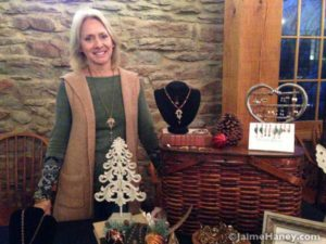 Becky Kiesel at her booth in Christmas in New Harmony