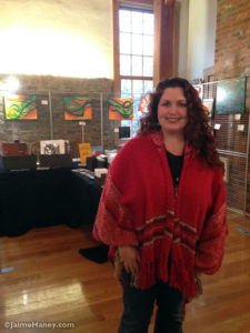 Jaime Haney in front of her art booth at the Artisans market in Christmas in New Harmony