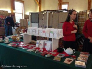 Elaine Wilson in her booth selling tea and music cd's.