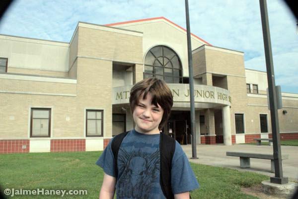 boy in front of Jr High school