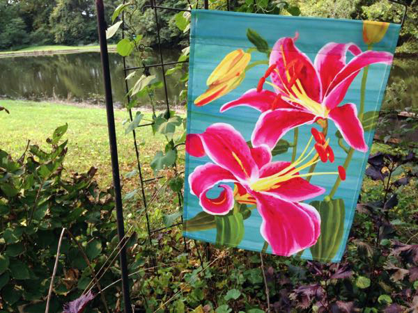 Garden flag with lilies on it