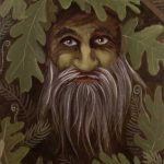 Forest Guardian is a green man painting with oak leaves, ferns and acorns
