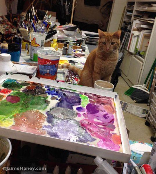 "Orange tabby kitty ""Loki"" watching me paint in my art studio"