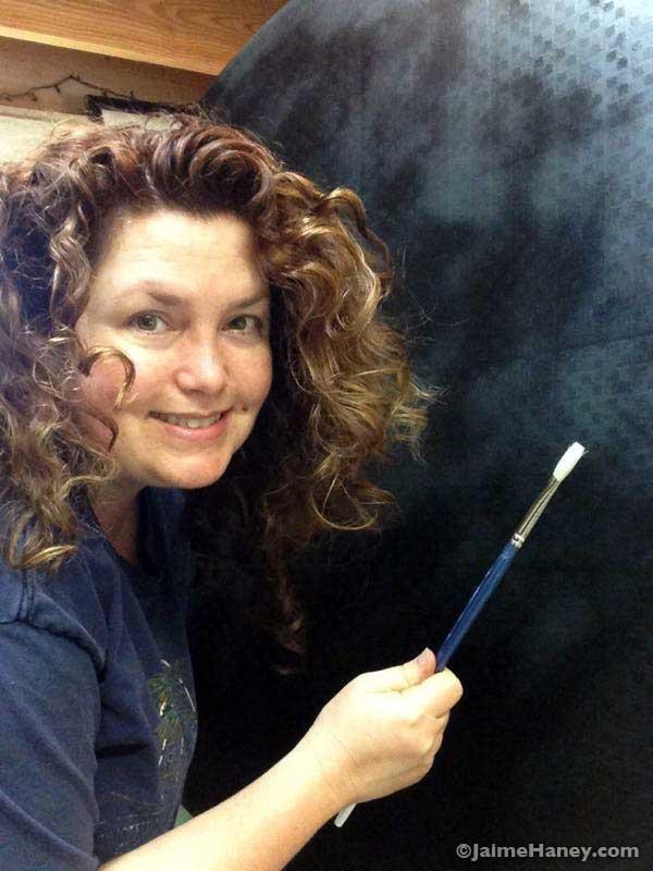 artist Jaime Haney holding paint brush