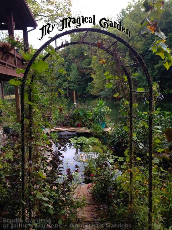 wrought iron garden arch at entrance of koi pond