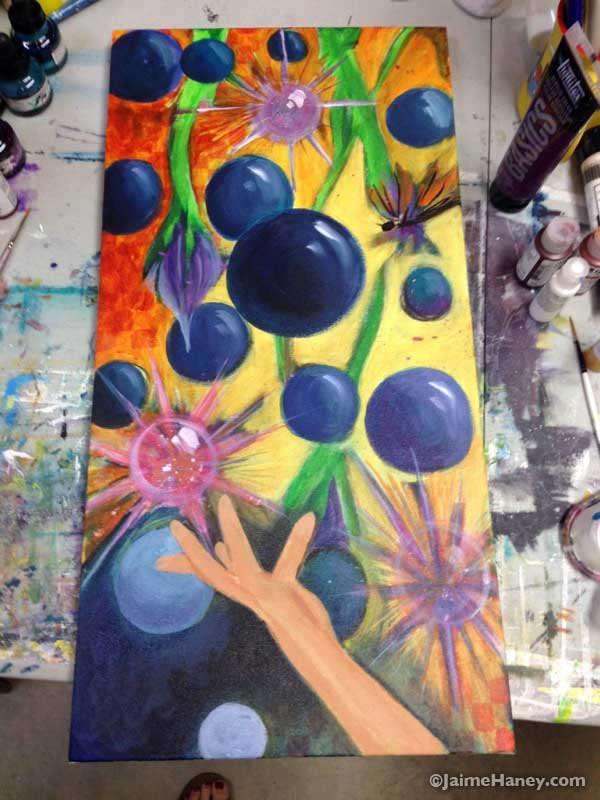 Painting in progress of a hand tossing blue balls in the air and a dragonfly