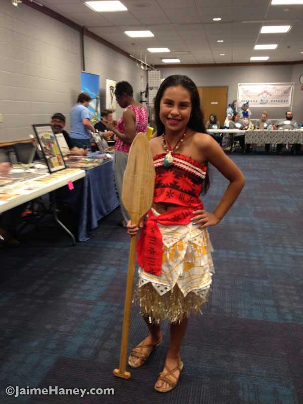 A young girl dressed as Moana